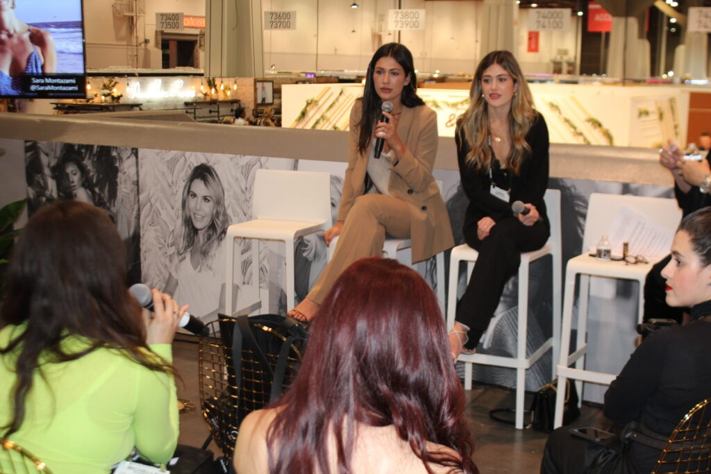 Fans listen to the Montazami sisters, Wendy Bendoni, & Sara Montazami guest speakers at the Magic fashion convention in Las Vegas, NV.